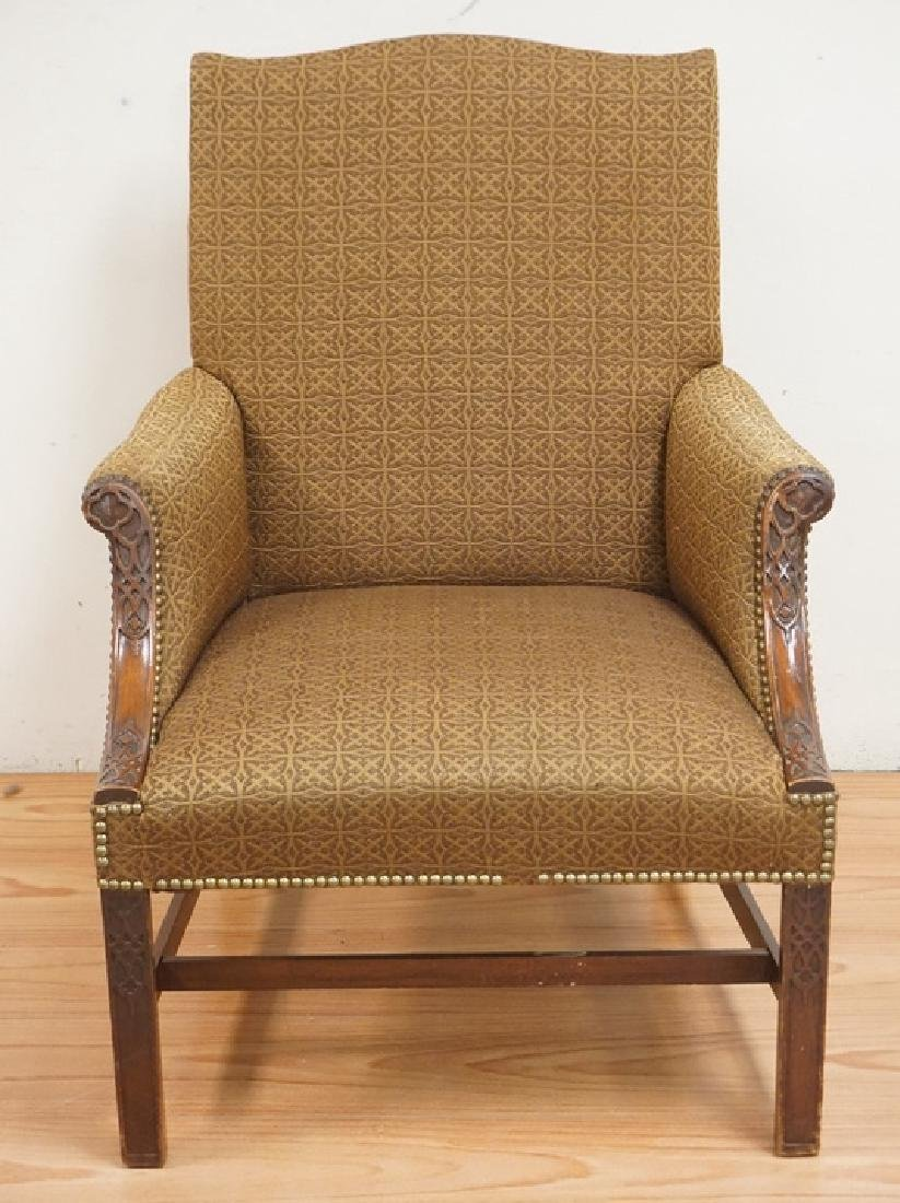 UPHOLSTERED ARMCHAIR WITH A CHIPPENDALE STYLE CARVED