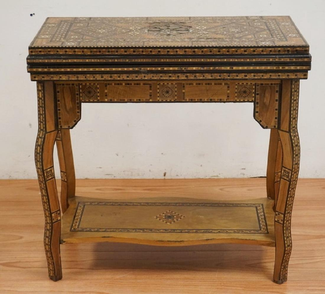 INTRICATELY INLAID GAME TABLE WITH INLAY OF VARIOUS