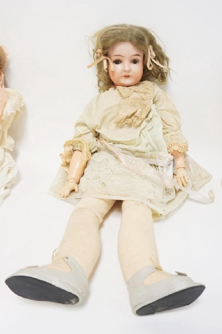 QUEEN LOUISE BISQUE HEAD DOLL. 27 1/2 IN