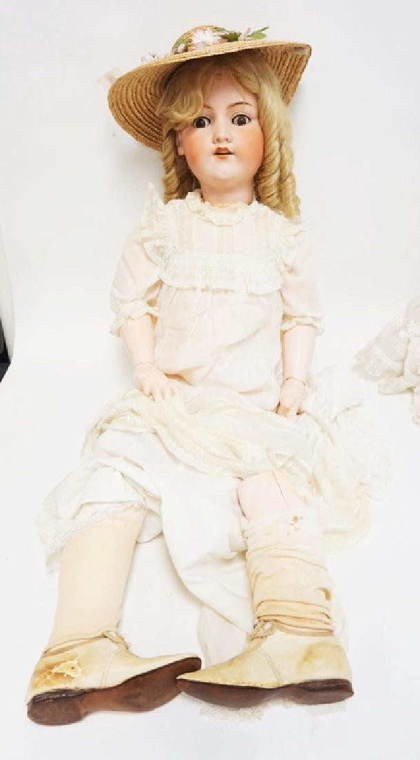 LARGE AM 390 BISQUE HEAD DOLL. 37 1/2 IN. BOTTOM OF ONE