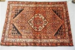 ANTIQUE HAND WOVEN ORIENTAL RUG MEASURING 7 FT X 5 FT.