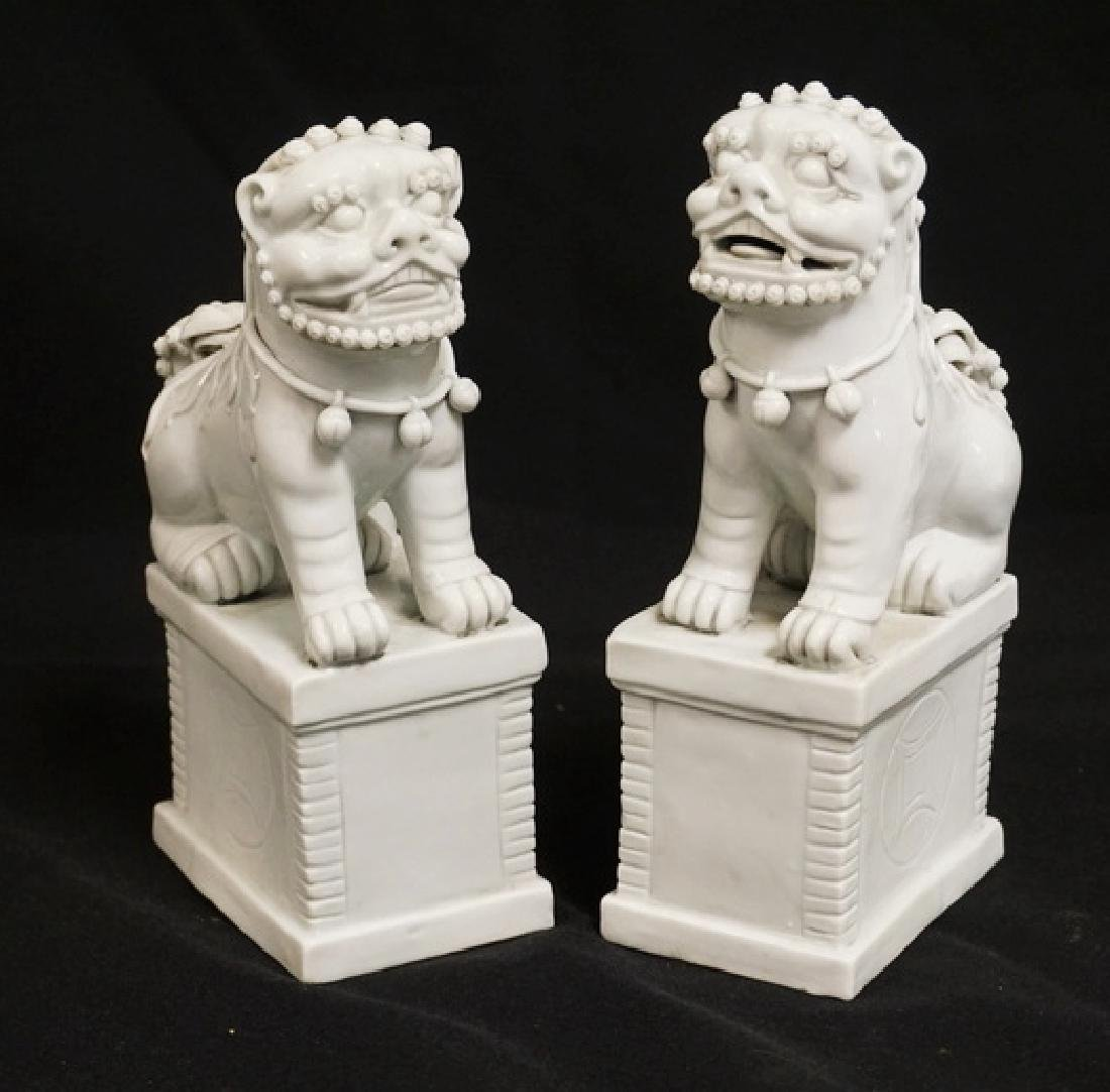 PAIR OF BLANC DE CHINE FOO DOG FIGURES. 7 1/4 INCHES