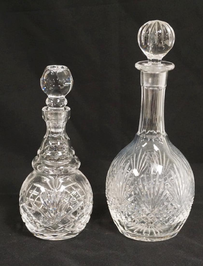 LOT OF 2 CRYSTAL DECANTERS. TALLEST IS 12 INCHES.