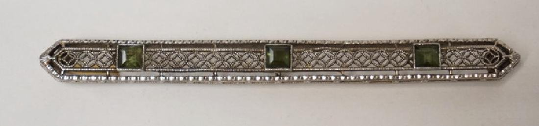 14K GOLD AND EMERALD BAR PIN MEASURING 2 1/2 INCHES