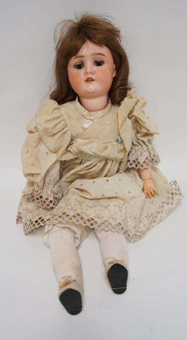 ANTIQUE GERMAN BISQUE HEADED DOLL MEASURING 25 INCHES