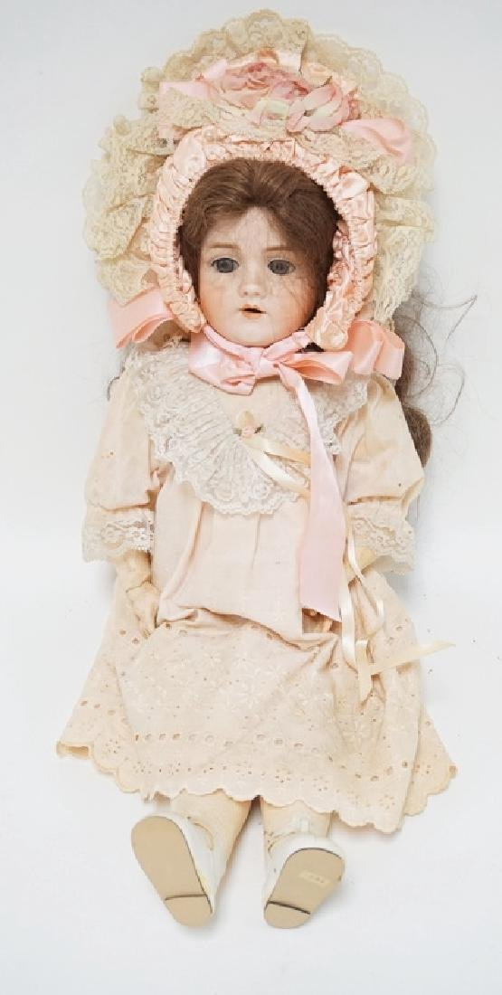 WALKURE BISQUE HEADED DOLL MESAURING 24 INCHES LONG.