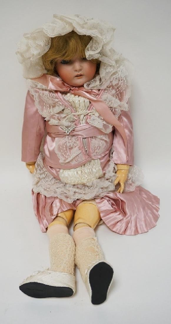 ANTIQUE GERMAN BISQUE HEADED DOLL MARKED *GERMANY 171*.