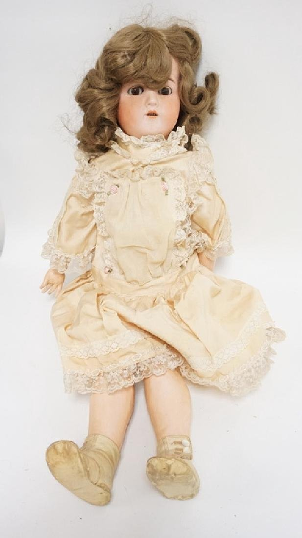 BISQUE HEAD DOLL MARKED GERMANY B 6. 25 IN H