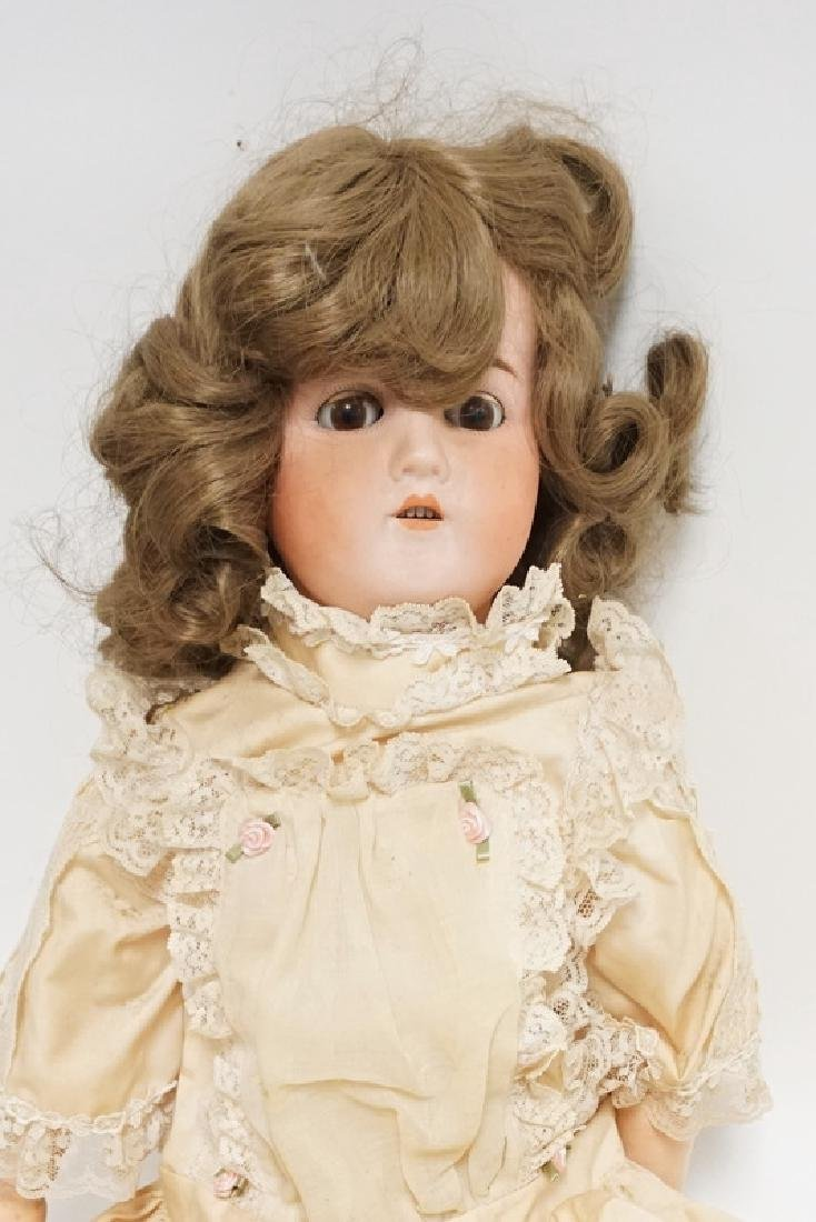 BISQUE HEAD DOLL MARKED GERMANY B 6. 25 IN H - 2
