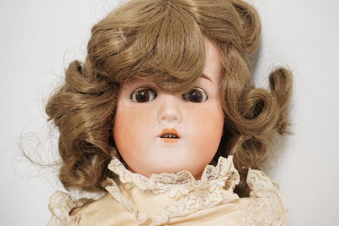 BISQUE HEAD DOLL MARKED GERMANY B 6. 25 IN H - 3