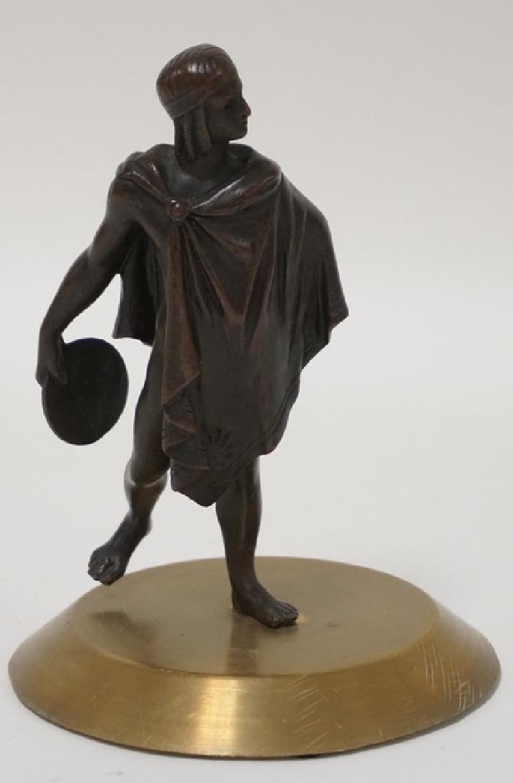 BRONZE PATINATED CLASSIUCAL FIGURE ON A POLISHED BASE.