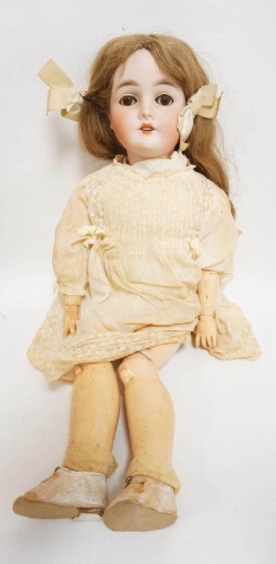 QUEEN LOUISE BISQUE HEAD DOLL. 23 IN