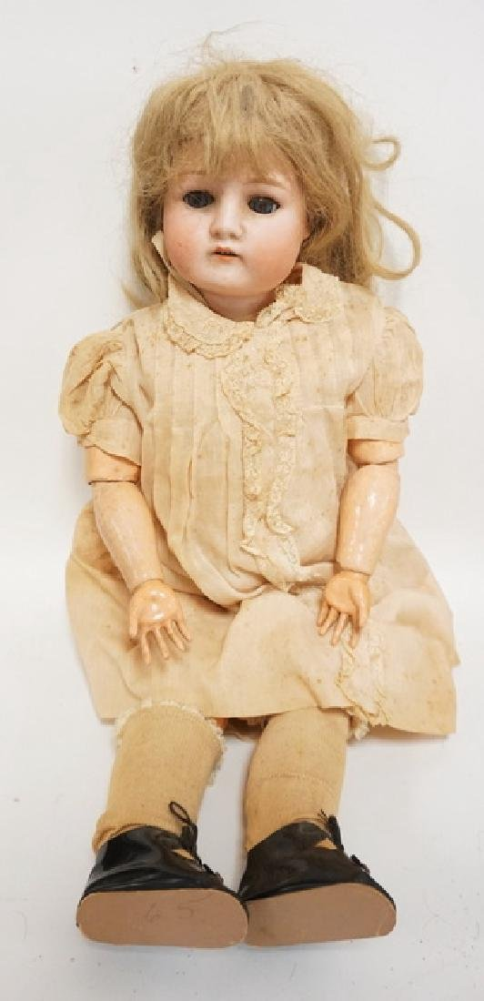 GERMAN BISQUE HEAD DOLL. 22 IN
