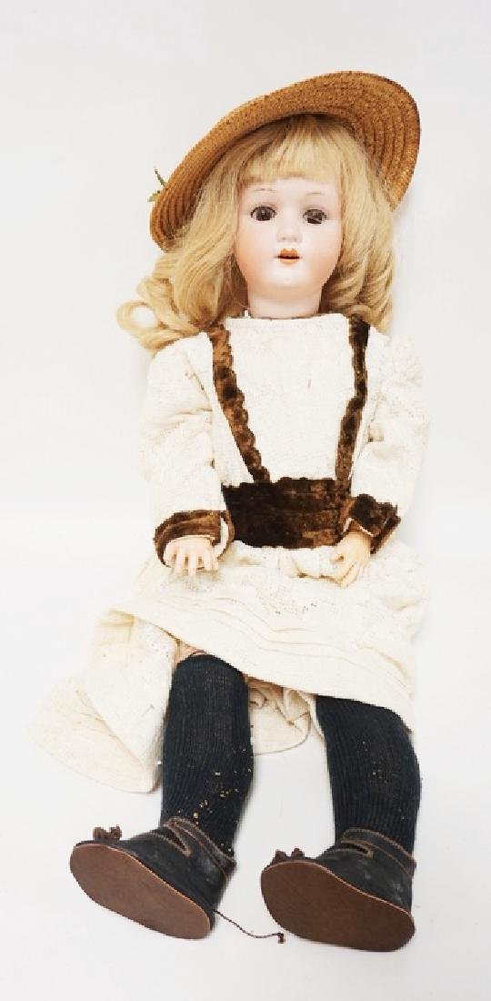 HEUBACH BISQUE HEAD DOLL. 23 IN