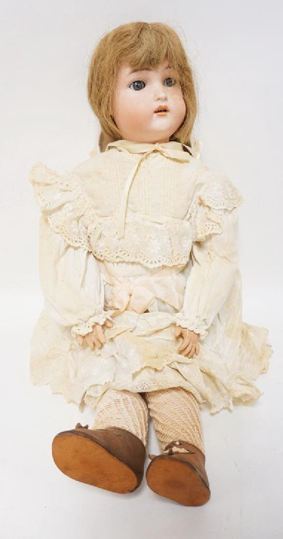 BISQUE HEAD DOLL MARKED AW W GERMANY. 23 IN