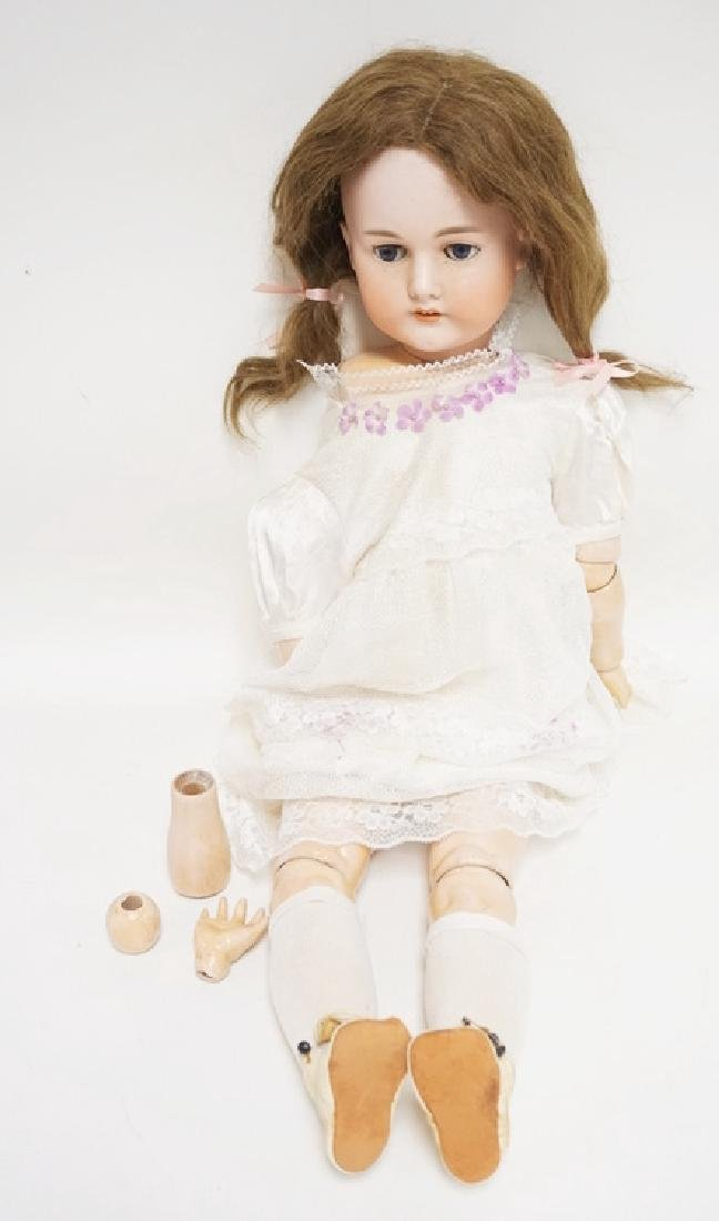 C.M. BERGMANN BISQUE HEAD DOLL. 31 INCHES LONG.