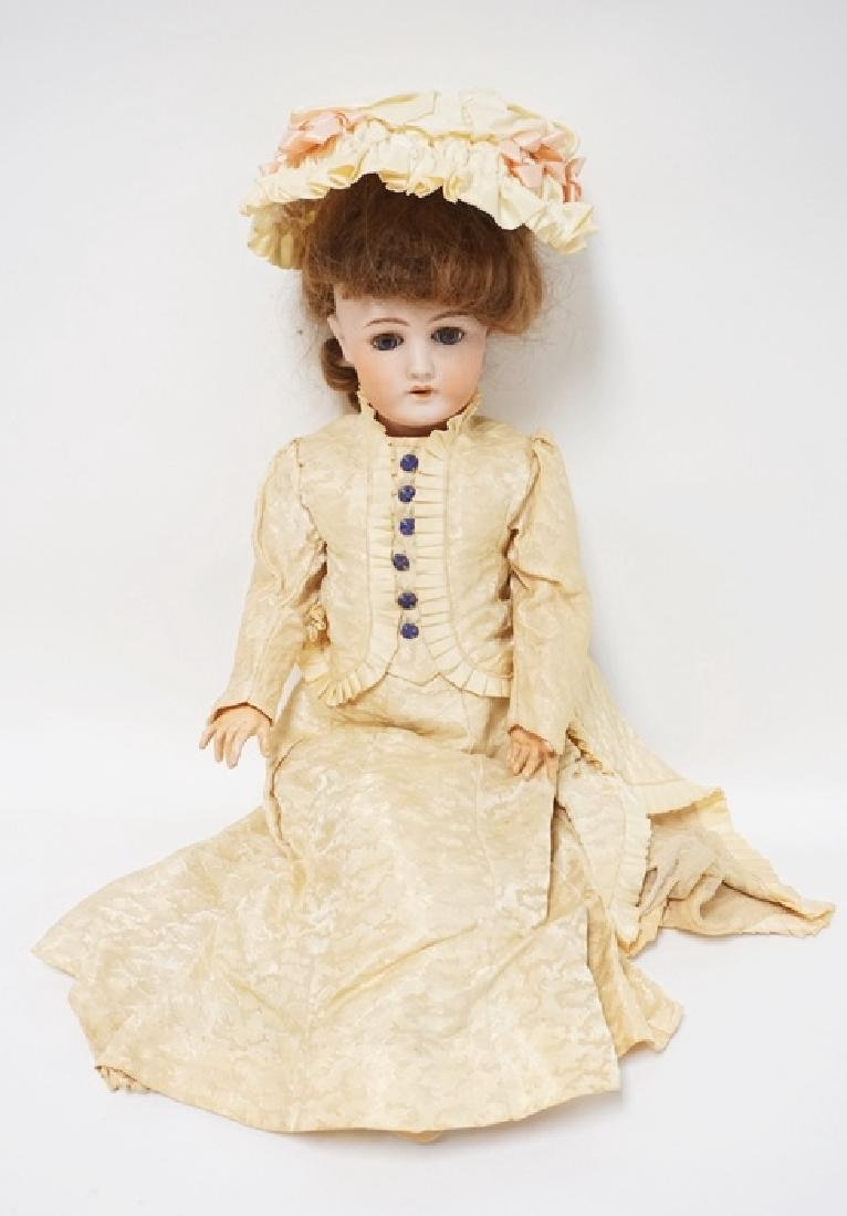 GERMAN BISQUE HEAD DOLL. 22 INCHES LONG.