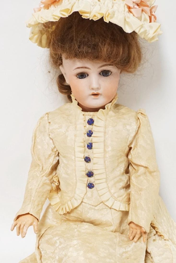 GERMAN BISQUE HEAD DOLL. 22 INCHES LONG. - 2
