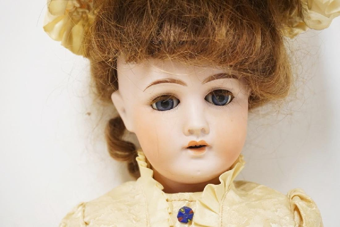 GERMAN BISQUE HEAD DOLL. 22 INCHES LONG. - 3