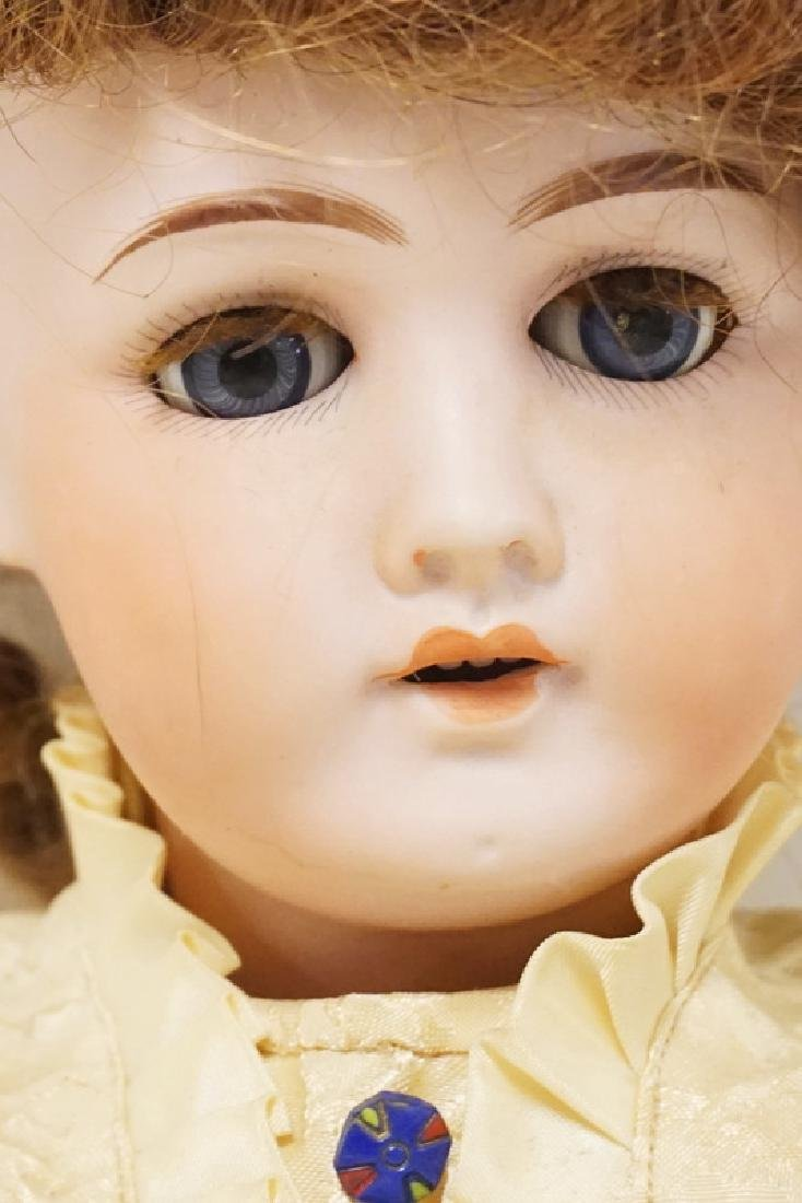 GERMAN BISQUE HEAD DOLL. 22 INCHES LONG. - 4