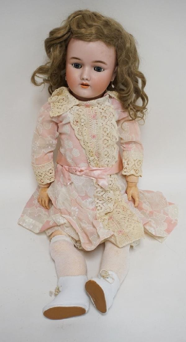 HEINRICH BISQUE HEAD DOLL MEASURING 23 INCHES LONG.