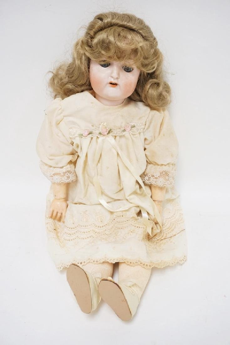 NIPPON BISQUE HEAD DOLL MEASURING 22 INCHES LONG.