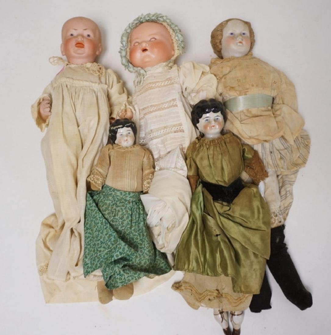 LOT OF 5 BISQUE & CHINA HEAD DOLLS. TALLEST IS 19