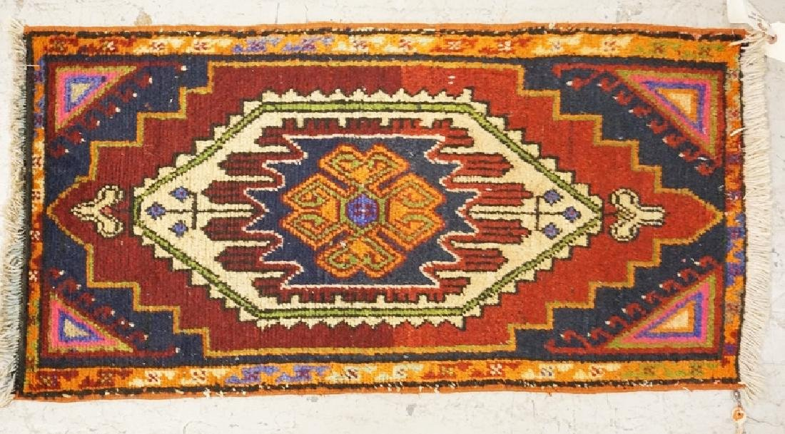 HAND WOVEN ORIENTAL RUG MEASURING 3 FT X 1 FT 7 INCHES.