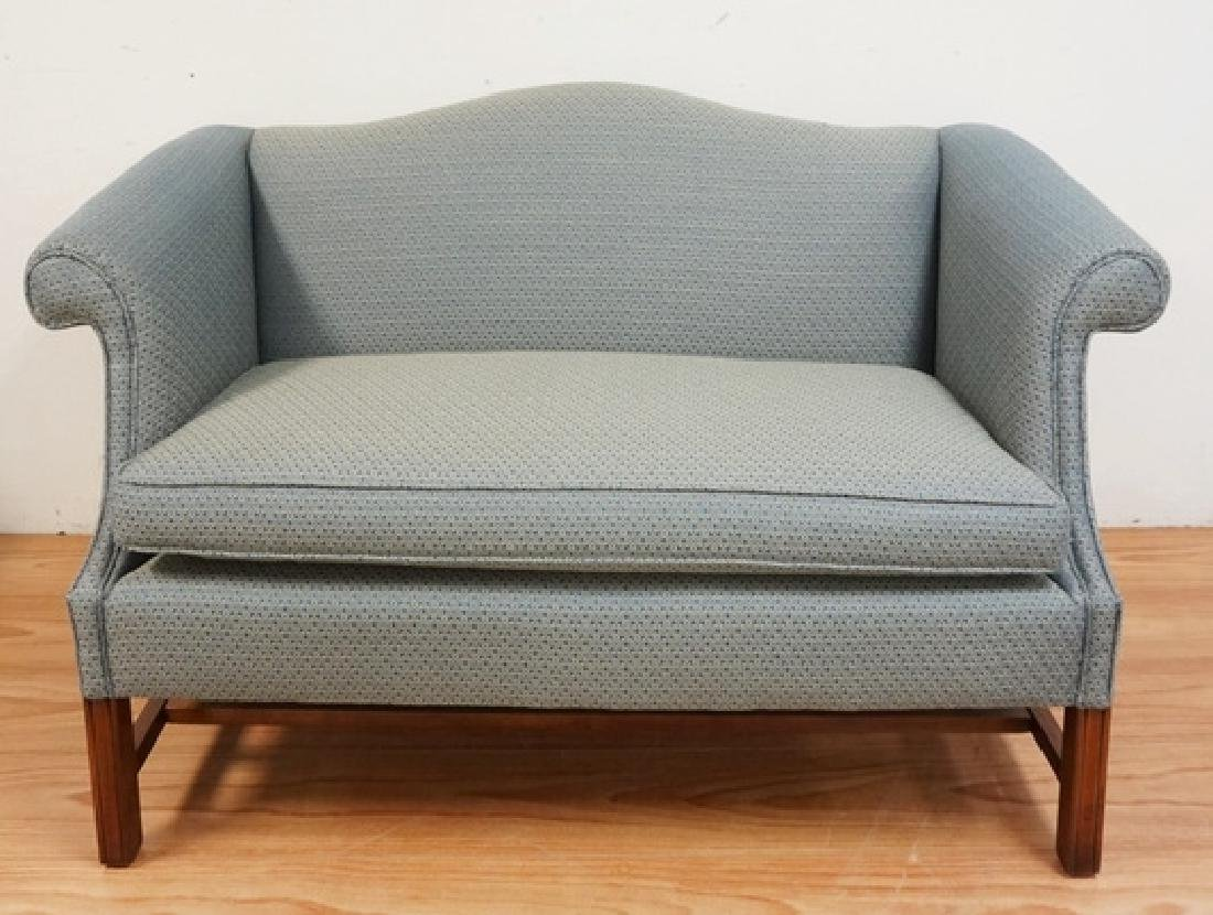 UPHOLSTERED SETTEE WITH CHIPPENDALE LEGS. 57 INCHES