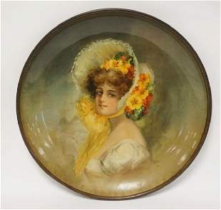 LARGE TIN CHARGER DECORATED WITH THE PORTRAIT OF A
