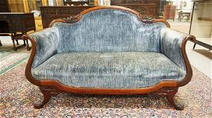 CARVED VICTORIAN LOVESEAT. 53 1/2 INCHES WIDE.