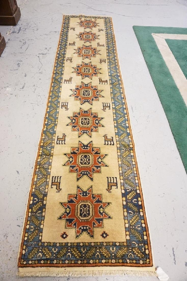 ORIENTAL RUNNER MEASURING 10 FT 7 X 2 FT 5 INCHES.