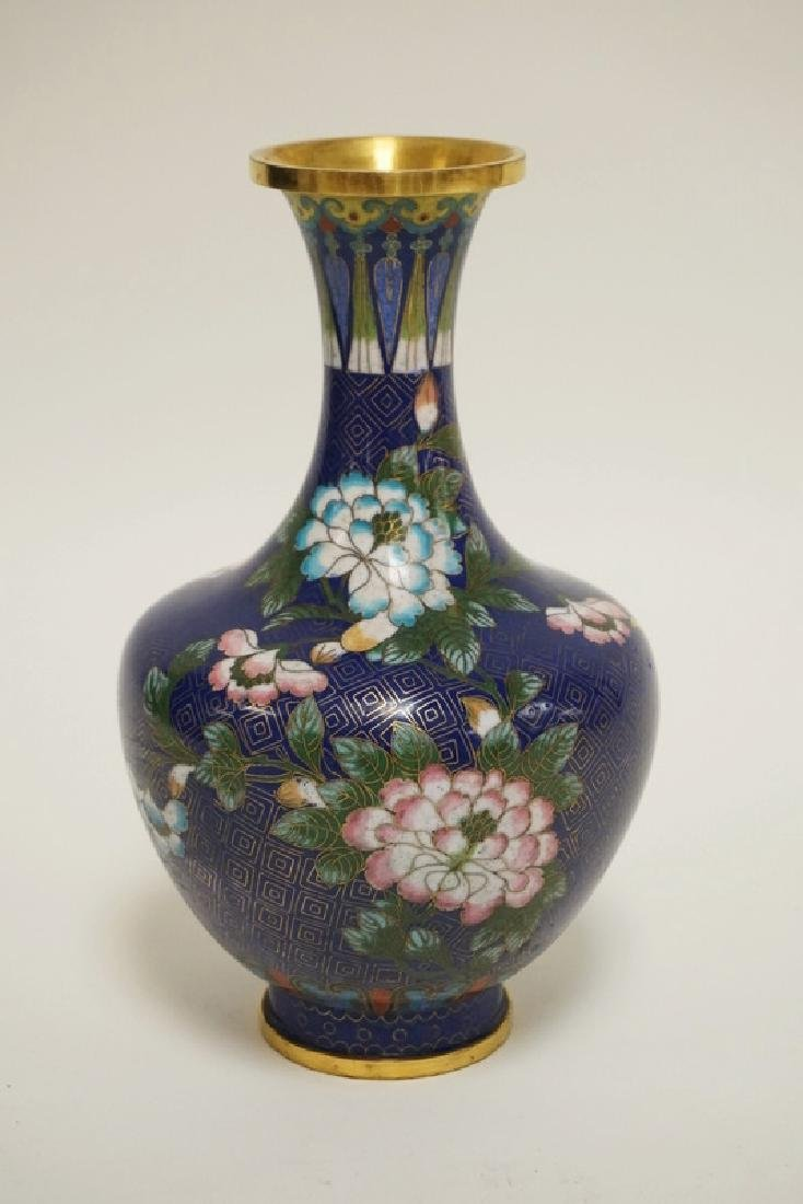 CLOISONNE VASE DECORATED WITH FLOWERS. 9 INCHES HIGH.
