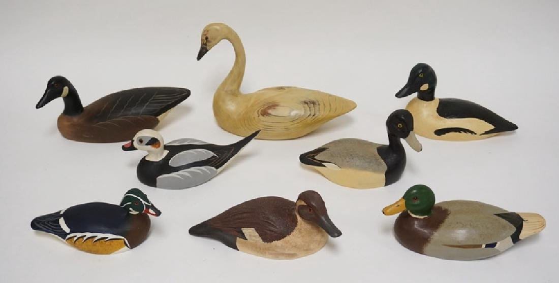LOT OF 8 CARVED AND PAINTED WOODEN DUCK DECOYS BY JOHN