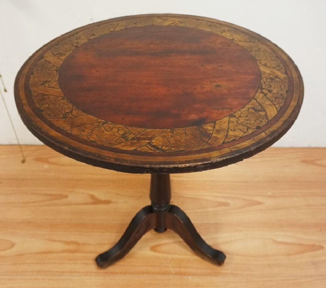 TILT TOP TABLE. THE TOP DECORATED WITH A BAND OF