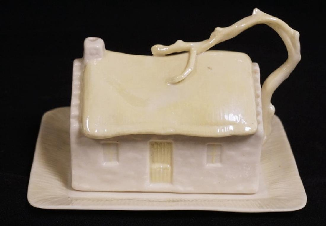 BELLEEK COVERED BUTTER DISH IN THE FORM OF A CABIN.