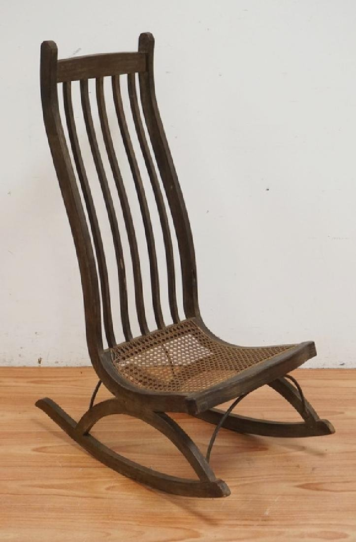 MID CENTURY MODERN ROCKING CHAIR WITH A CANE SEAT.