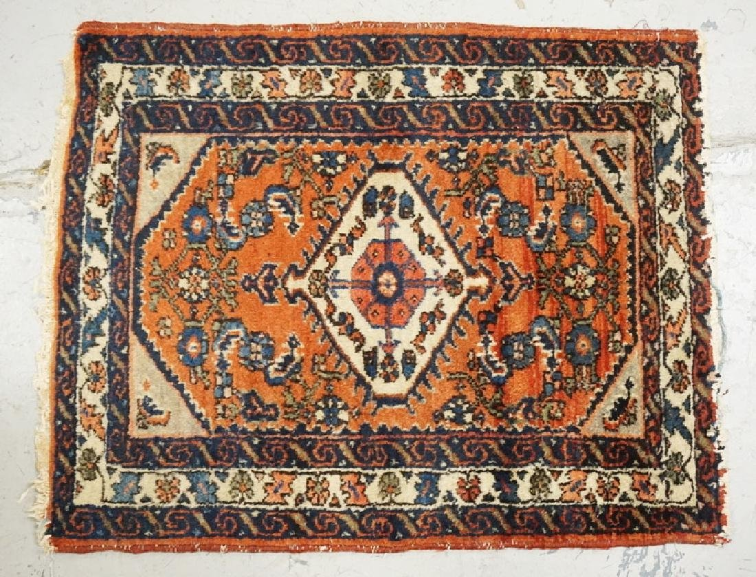 SMALL ORIENTAL RUG MEASURING 2 FT 2 X 2 FT 8 INCHES.