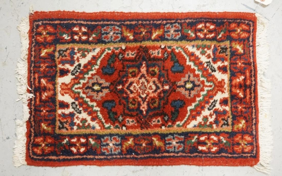 SMALL ORIENTAL RUG MEASURING 1 FT 11 INCHES X 1 FT 4