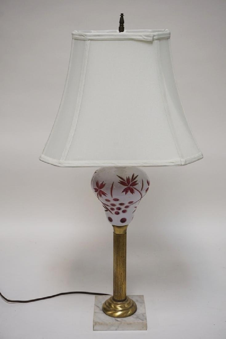MILK GLASS CUT TO CRANBERRY LAMP WITH A BRASS STEM AND