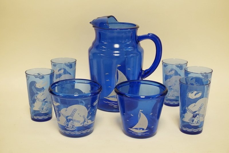 8 PIECE COBALT BLUE GLASSWARE DECORATED WITH SAILBOATS