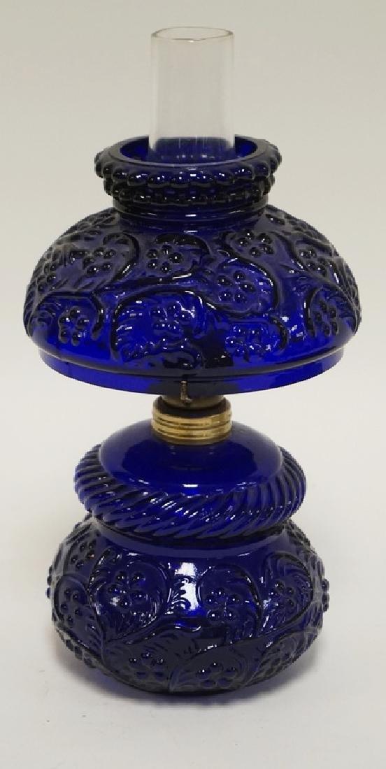 MINIATURE COBALT BLUE GLASS OIL LAMP. 8 1/2 INCHES