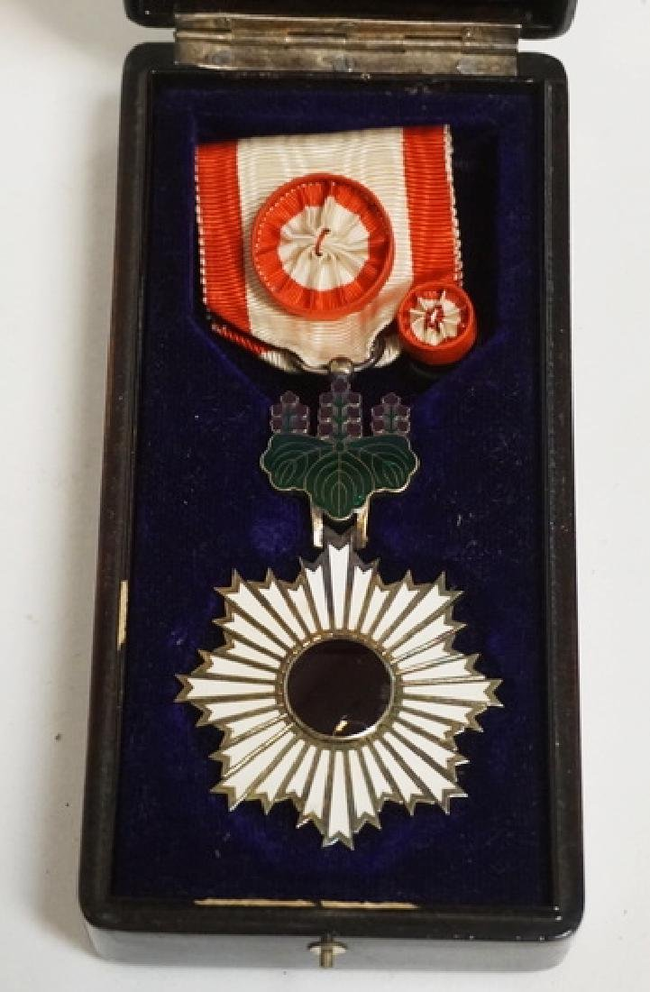 ORDER OF THE RISING SUN 4TH CLASS MEDAL WITH BOX. THE