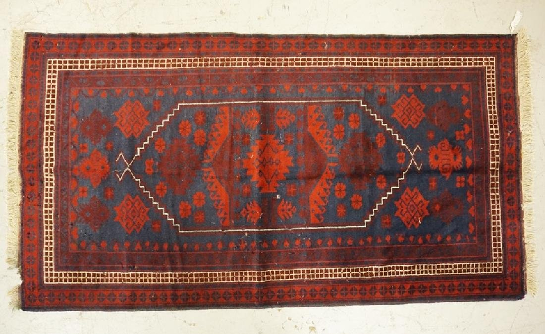 HAND WOVEN ORIENTAL RUG MEASURING 6 FT 3 INCHES X 3 FT