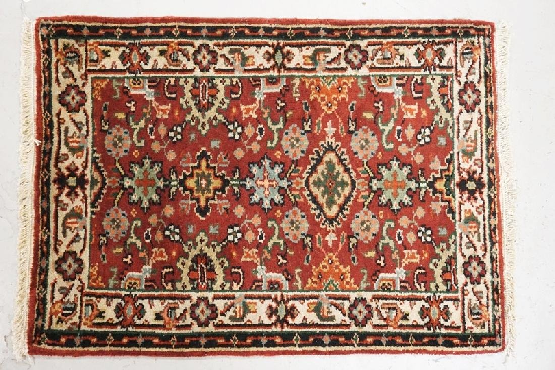 SMALL HAND WOVEN ORIENTAL RUG MEASURING 2 FT 11 X 2 FT