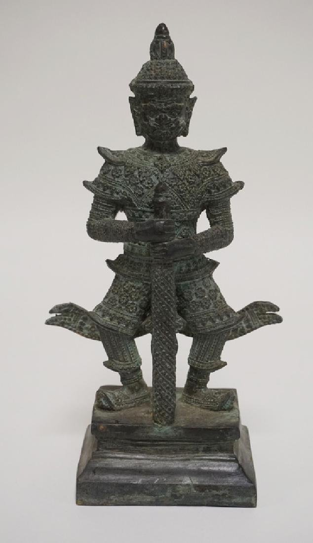 ASIAN BRONZE FIGURE OF A WARRIOR WITH A SWORD. 11 1/2