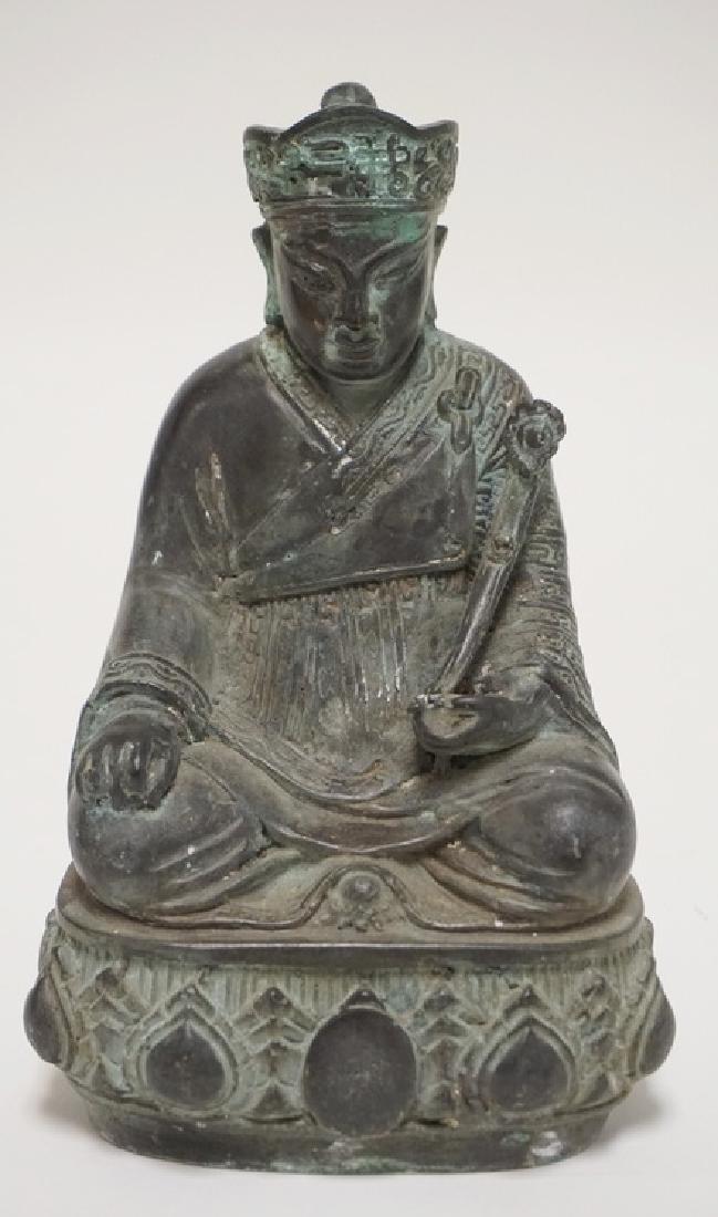 ASIAN BRONZE FIGURE OF A KNEELING MAN HOLDING A RUYI. 9