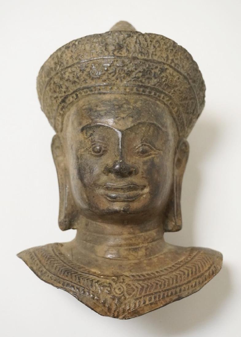 ASIAN BRONZE BUST OF A MAN WITH ELONGATED EARLOBES. 8