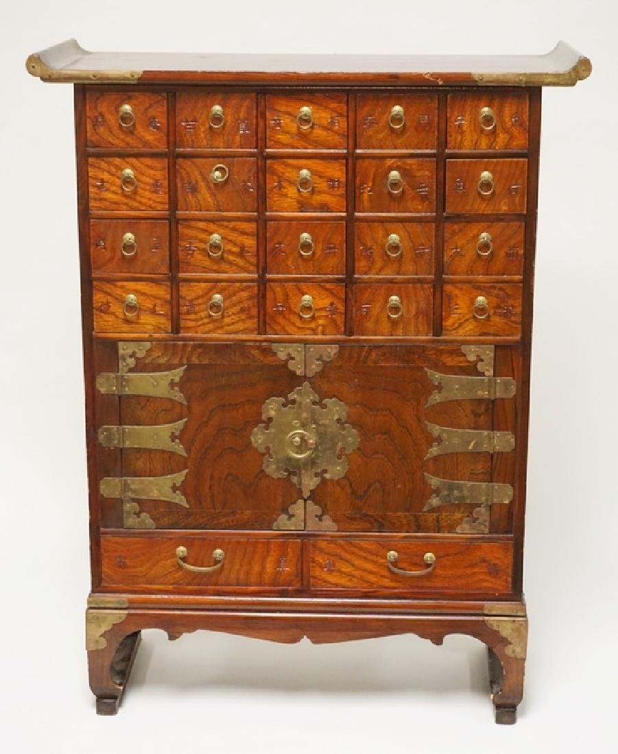 ASIAN CABINET HAVING 22 DRAWERS AND 2 DOORS. 31 INCHES