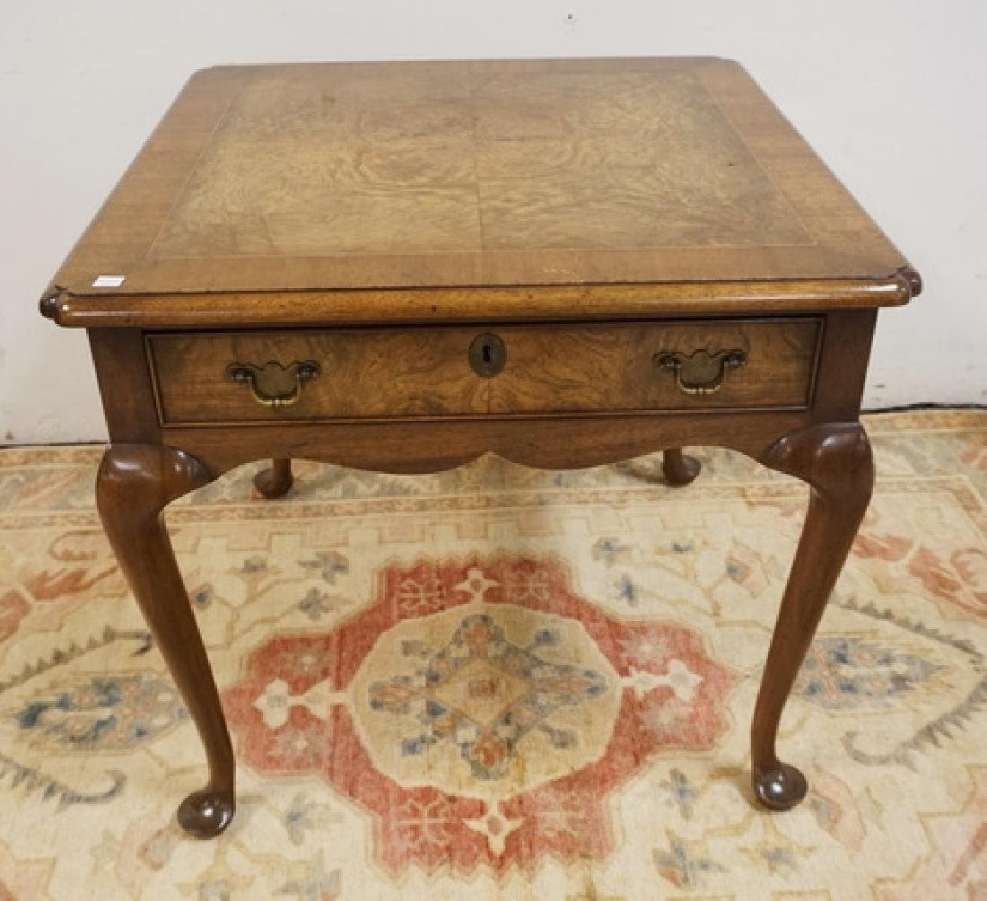 KITTINGER END TABLE WITH A BURLED AND BANDED TOP AND